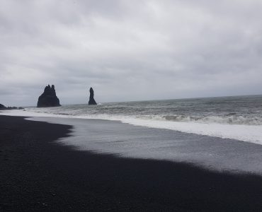Reynisfjara beach, Iceland - world-famous black-sand beach found on the South Coast of Iceland